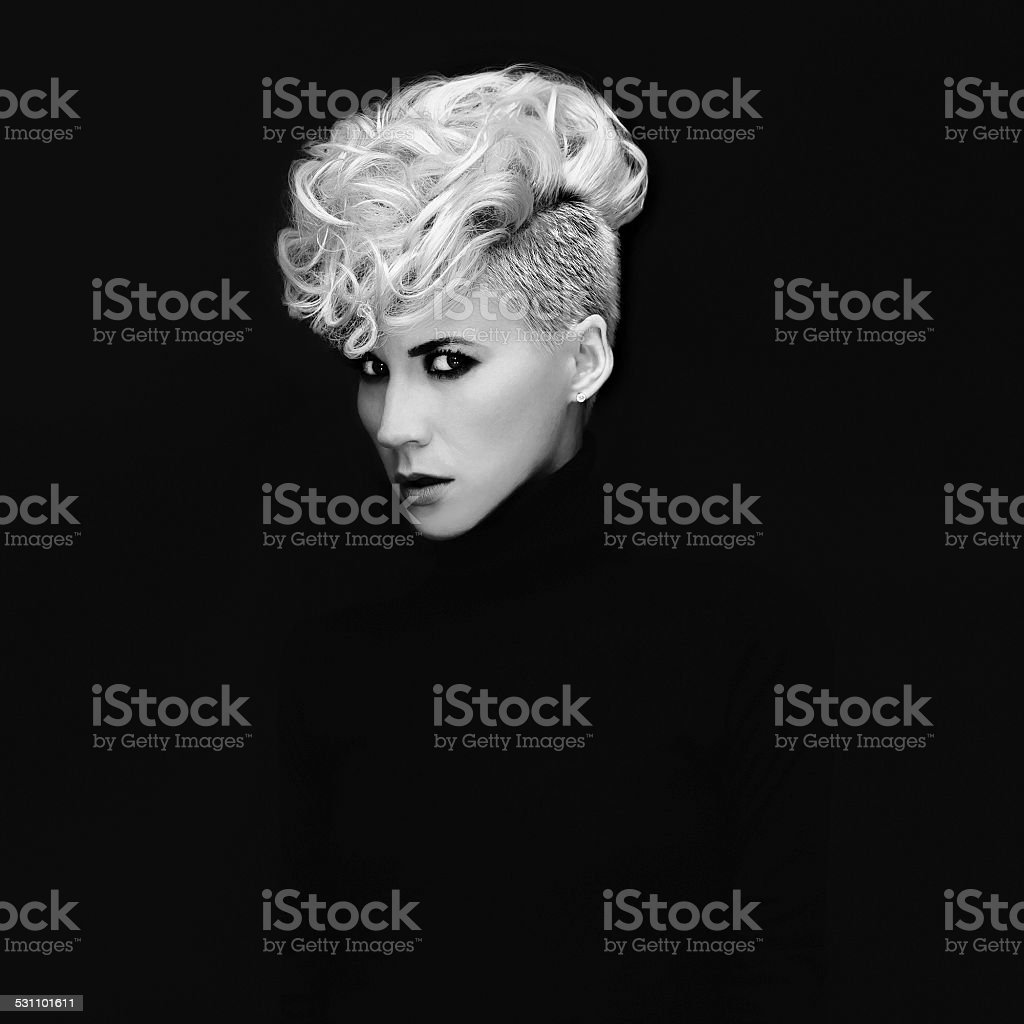 Sensual portrait lady with fashionable hairstyle on black backgr stock photo