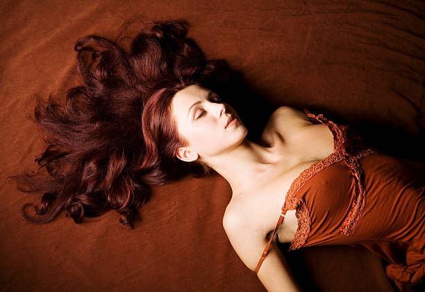 sensual portrait of a beautiful brown-haired woman stock photo