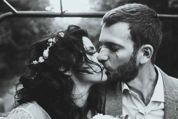 sensual portrait of kissing couple close-up. wind in her hair - hipster braut stock-fotos und bilder