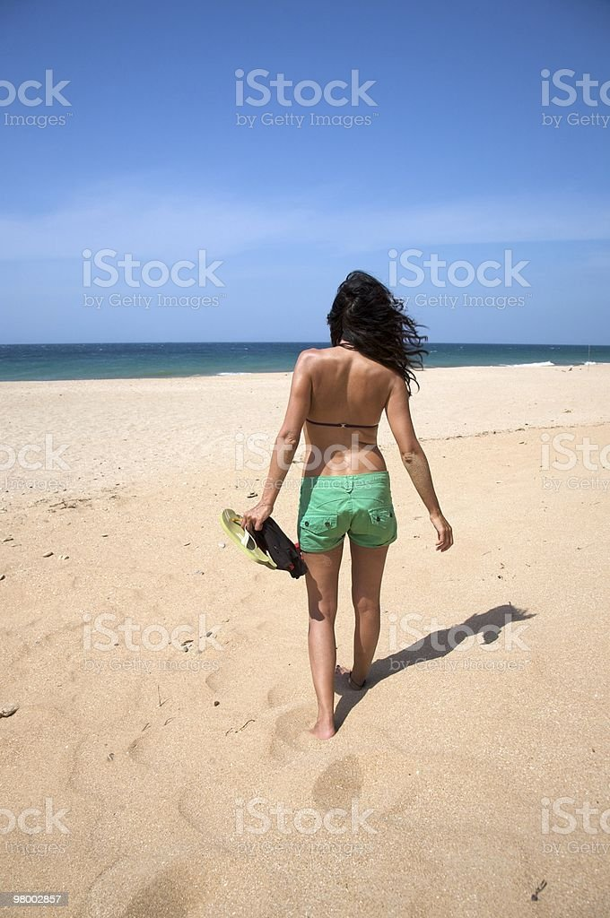 sensual woman flip-flop on hand walking beach vacation summer holidays royalty free stockfoto