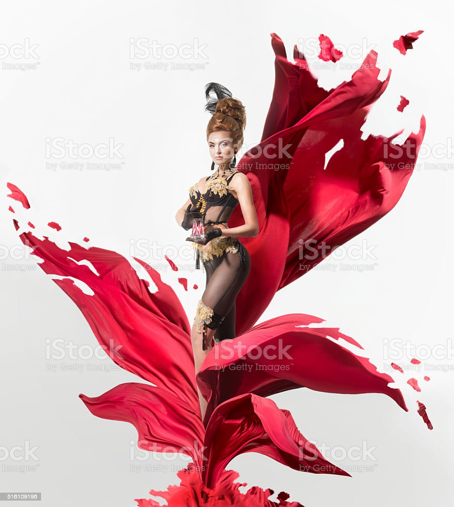 Sensual woman in a lacerated flower stock photo