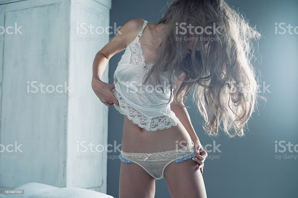 Sensual woman in bed stock photo