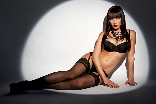 sensual woman in lingerie - black women wearing pantyhose stock photos and pictures