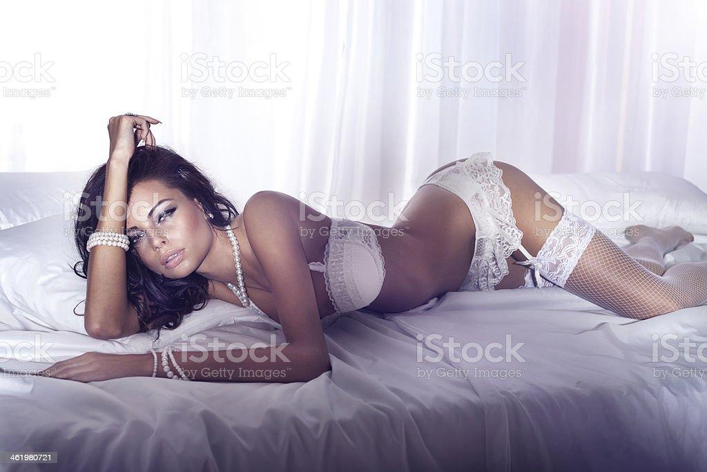 Sensual woman in white lingerie posing. stock photo