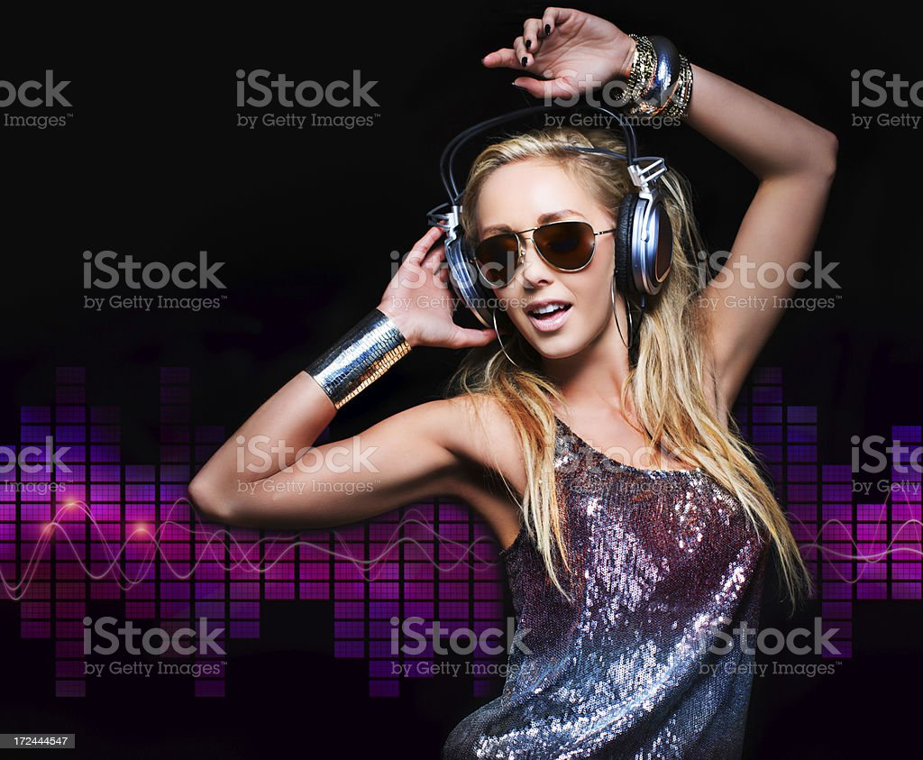 Sensual woman listening to music royalty-free stock photo