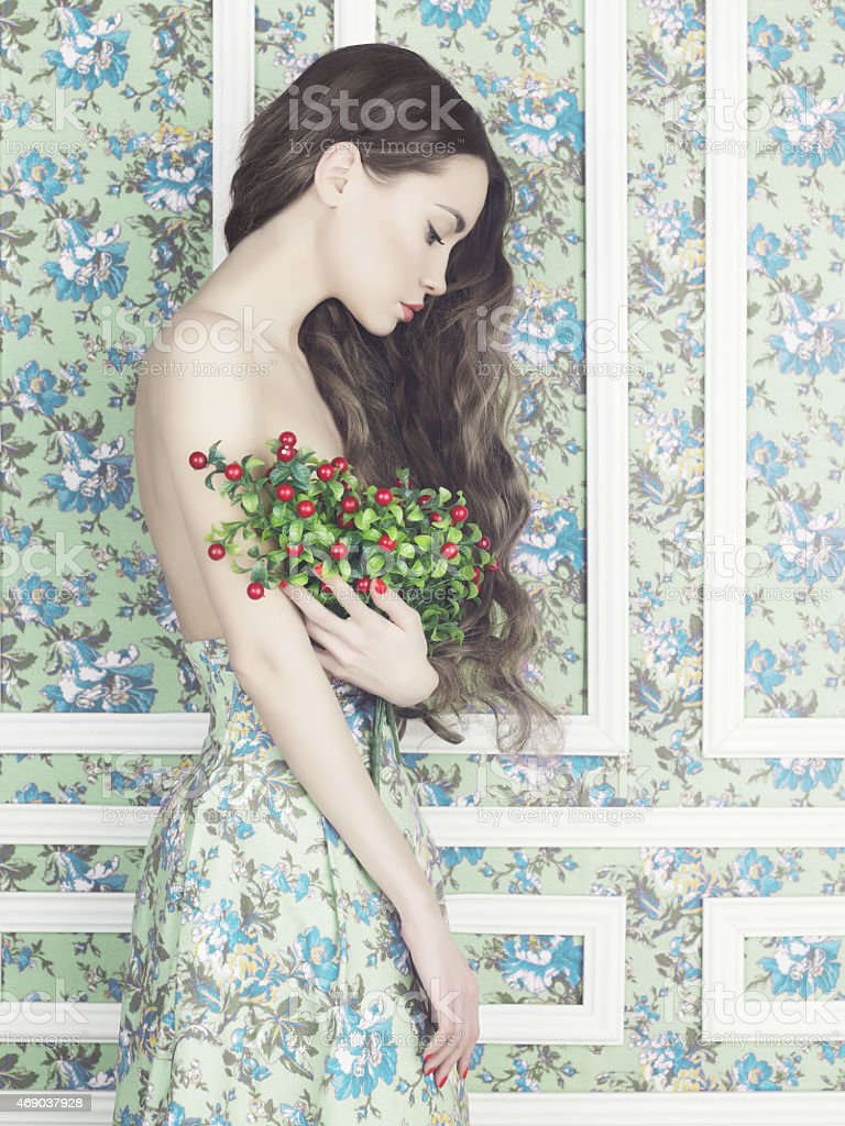 Sensual woman on floral background stock photo