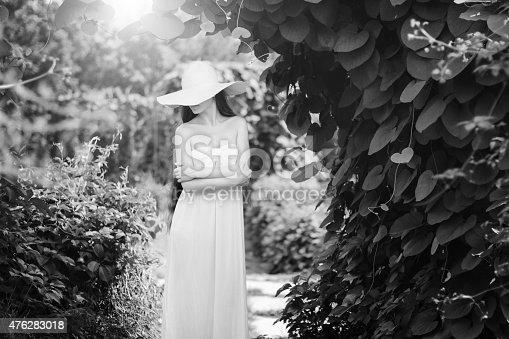 Young sensual woman walking in sunny garden