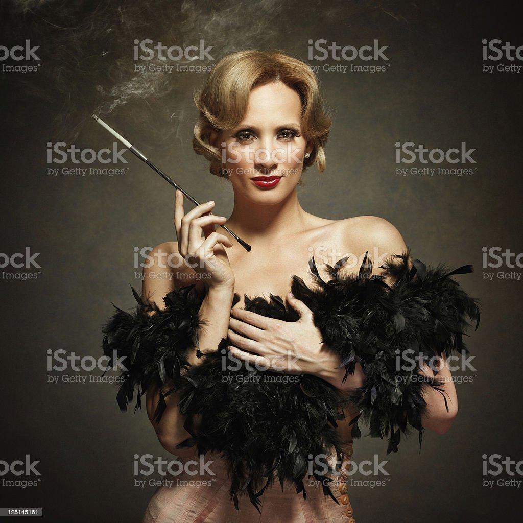 sensual woman smoking - vintage style stock photo