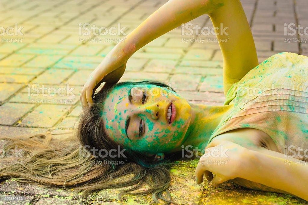 Sensual woman with colored powder around her Lizenzfreies stock-foto