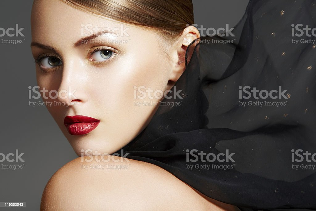 Sensual woman with luxury make-up, sexy lips and black scarf stock photo