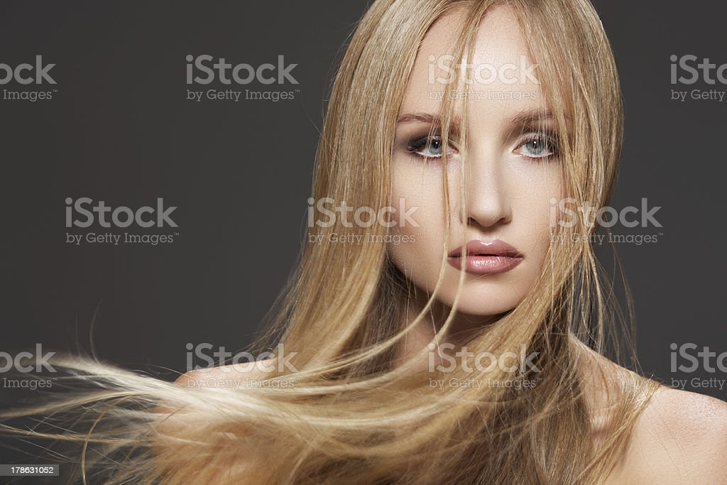 Sensual woman with windswept hair and fashion make-up stock photo