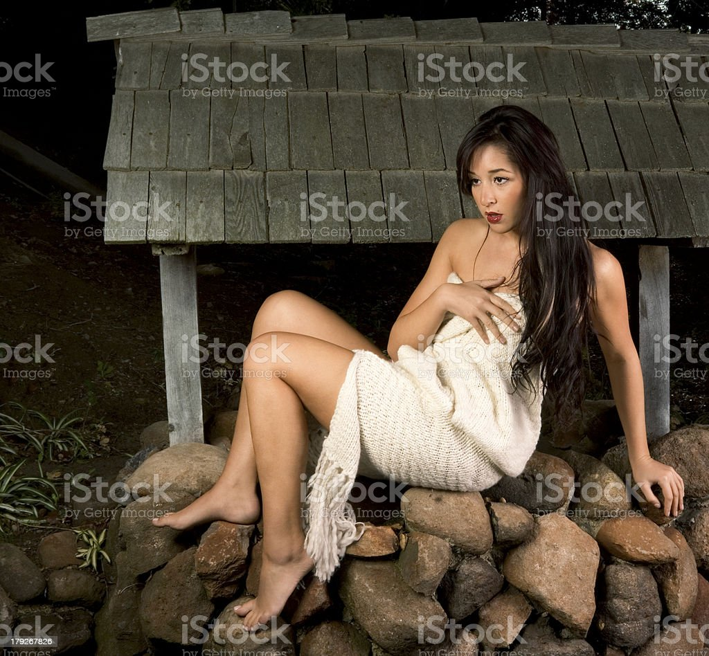 Sensual woman wrapped in scarf outdoors by well royalty-free stock photo