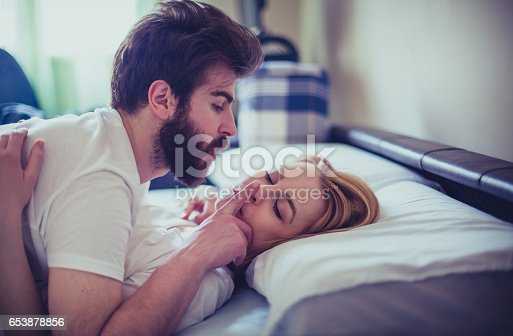 istock Sensual young couple in the bed in the morning 653878856