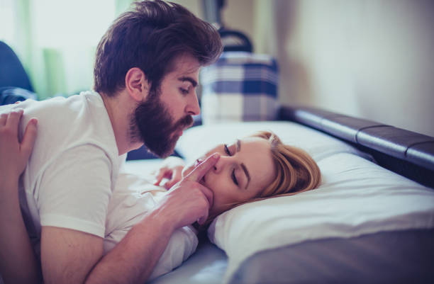 Sensual young couple in the bed in the morning Sensual young couple in the bed in the morning real couples making love stock pictures, royalty-free photos & images