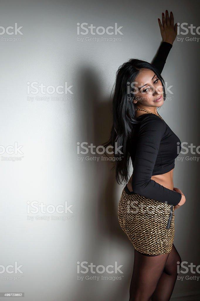Sensual young woman posing in black crop top and skirt stok fotoğrafı