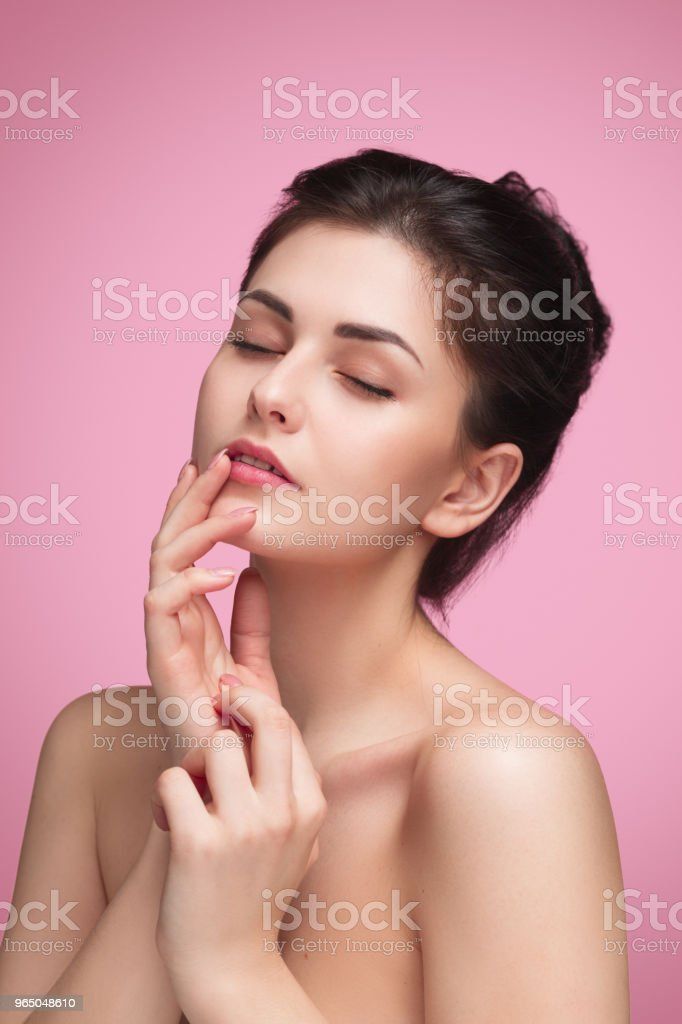 Sensual young woman touching face with eyes closed royalty-free stock photo