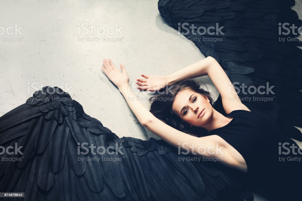 Sensuality Woman Black Angel Relaxing stock photo