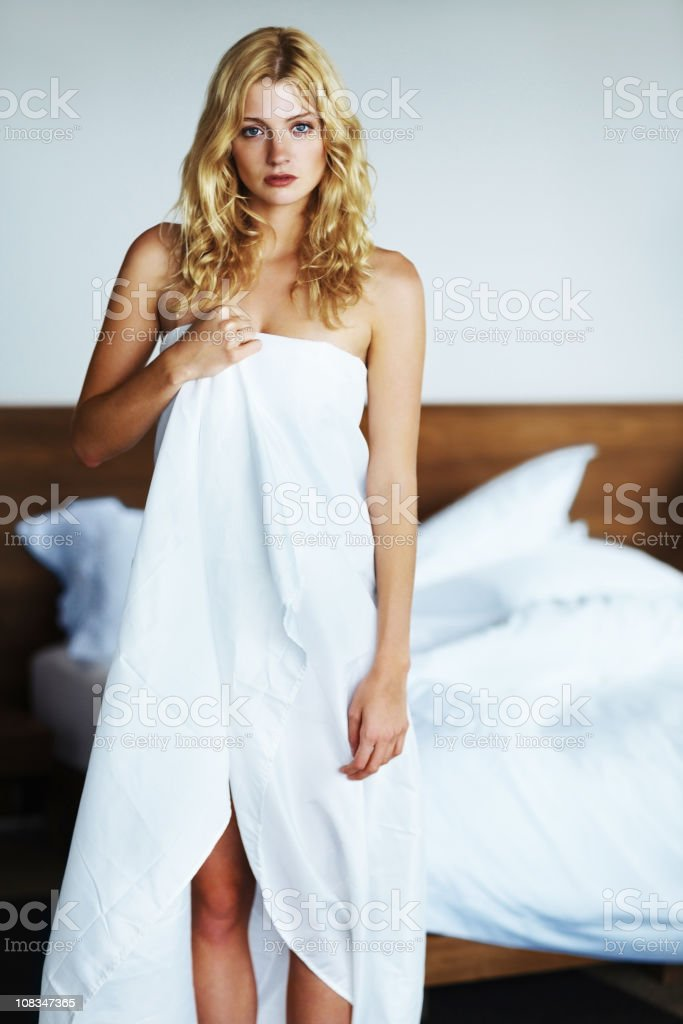 sensuous naked girl wrapped in white bed sheet at home stock photo more pictures of 20 29. Black Bedroom Furniture Sets. Home Design Ideas
