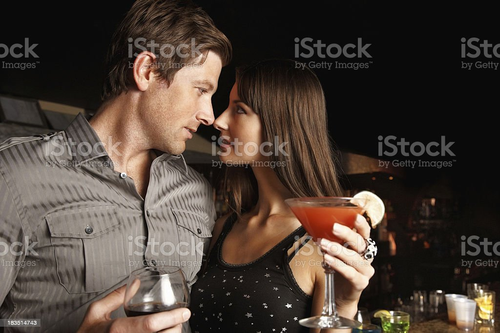 Sensuous, romantic couple with cocktail and wine at a party royalty-free stock photo