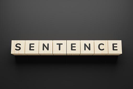 Sentence word written in wooden blocks.