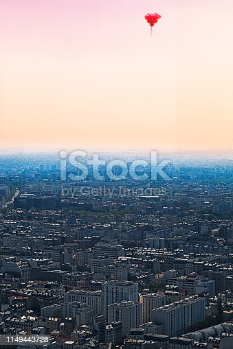 View of Paris with Red Balloons in a Heart Shape