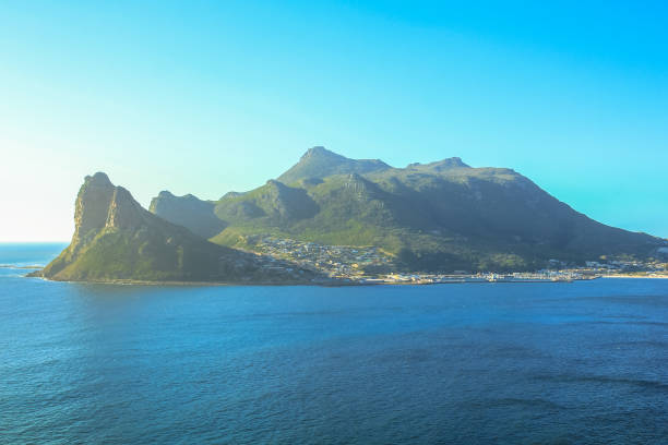 Sentinel peak in Hout Bay The view of Sentinel peak in Hout Bay from the scenic Chapman's Peak Drive, Cape Town, South Africa. hout stock pictures, royalty-free photos & images