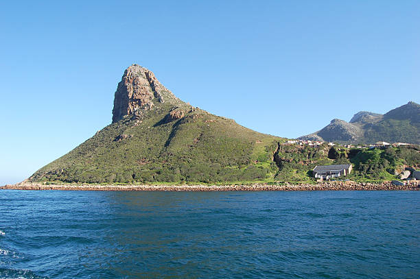 Sentinel Peak view of the Sentinel peak at the entrance to Hout Bay, South Africa hout stock pictures, royalty-free photos & images