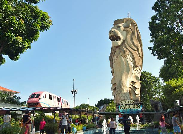 Sentosa Merlion park Singapore City, Singapore - May 9, 2015: Unidentified people and Merlion statue at Sentosa Merlion park in Sentosa island, Singapore.  merlion statue stock pictures, royalty-free photos & images