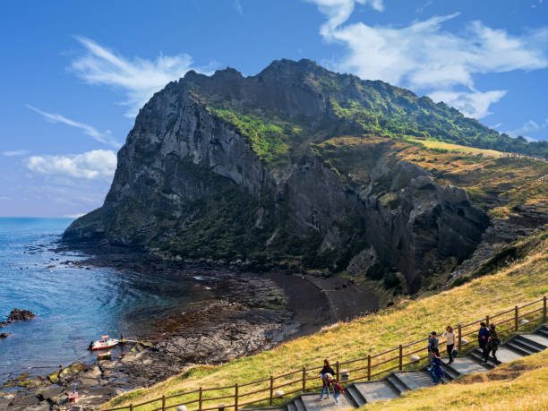 seongsan ilchulbong volcanic crater landscape - jeju island stock photos and pictures