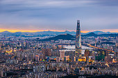 istock Seoul City skyline and downtown and skyscraper at night  is The best view and beautiful of South Korea at Namhansanseong mountain. 1257892405