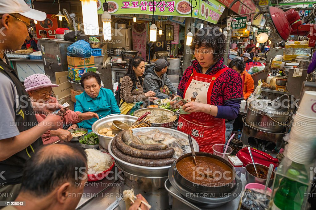 Seoul local people eating at street market food stall Korea royalty-free stock photo