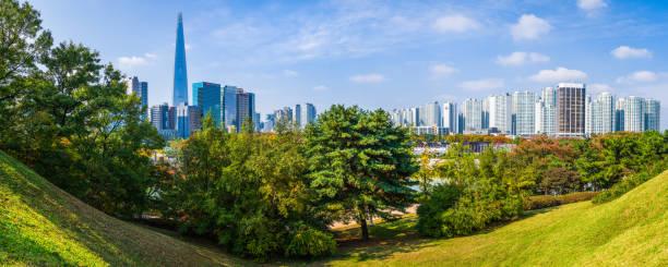 Seoul Lotte World Tower overlooking highrise cityscape park panorama Korea stock photo