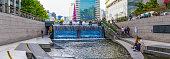 istock Seoul people relaxing along Cheonggyecheon Stream between skyscrapers panorama Korea 1341854558