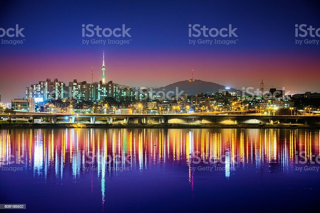 Seoul skyline at night from Han River with reflection stock photo