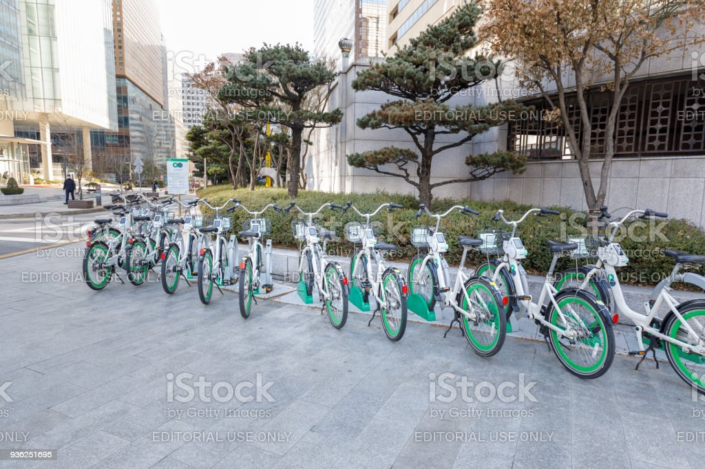 Seoul's public bike rental system. The Ddaleungee bikes are parked at a docking station near Subway Station or Bus Station in Seoul stock photo