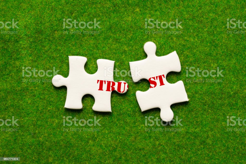 separate two jigsaw puzzle with trust wording stock photo