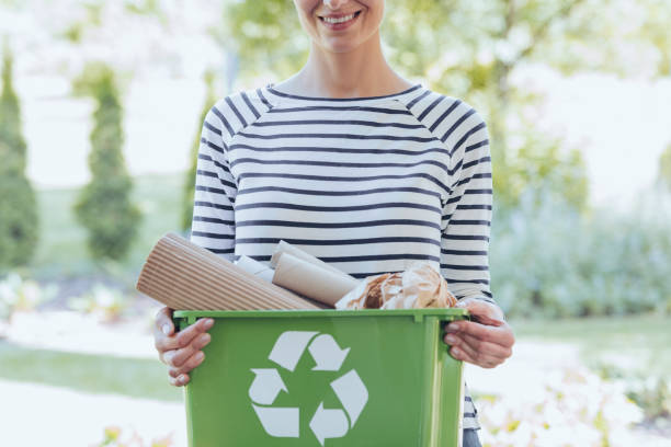 separating waste to save resources - recycling bin stock photos and pictures