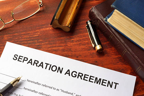 separation agreement form on an office table. - separation stock photos and pictures