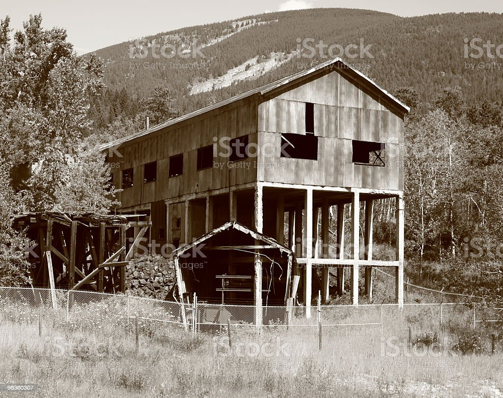 sepia abandoned mine surrounded by fence royalty-free stock photo