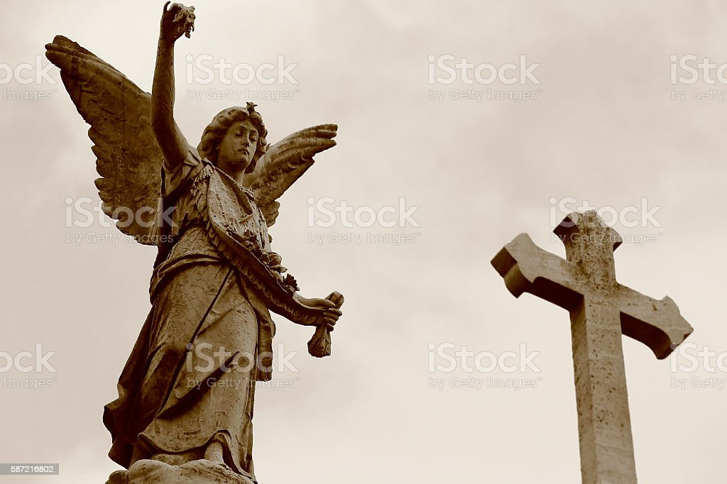 Sepia Beautiful peaceful Madonna Angel Memorial grave, Cross, Recoleta cemetery stock photo