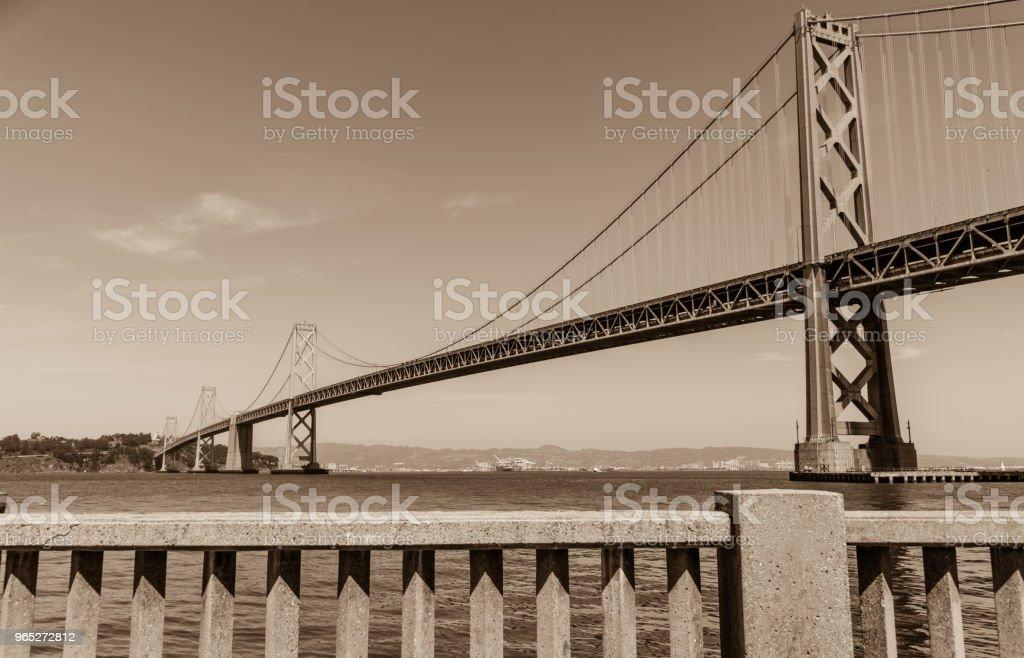 Sepia Finish Oakland Bay Bridge to San Francisco , California Suspension bridge over the Bay Area zbiór zdjęć royalty-free