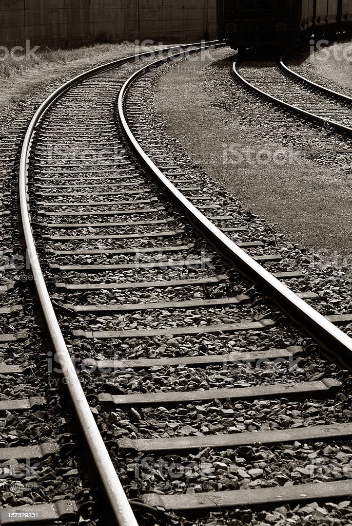 Sepia image of railroad tracks minimizing in the distance royalty-free stock photo
