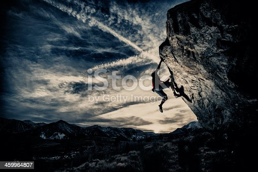 Rock climbing in a dramatic setting.