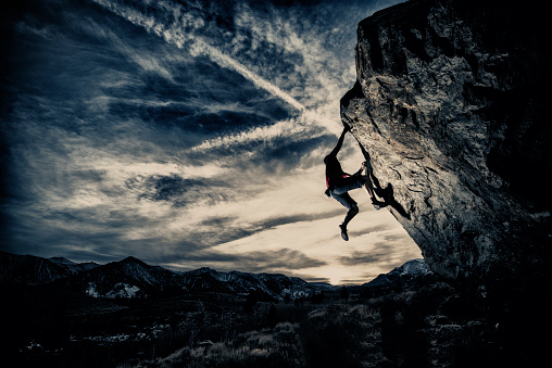 Rock climbing in a dramatic setting.