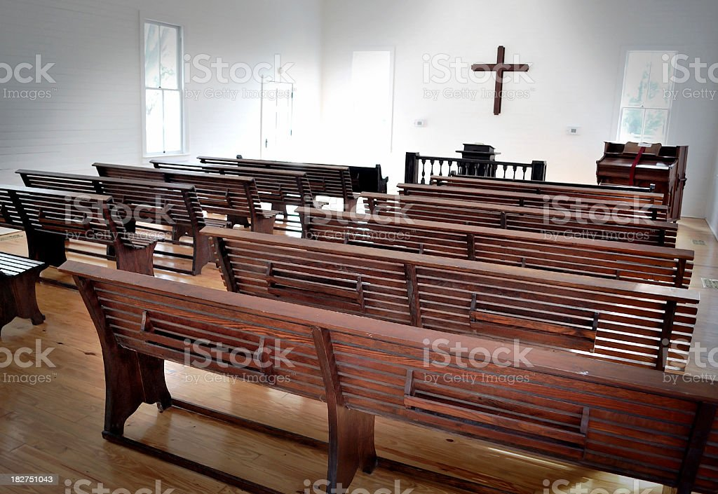Sepia Rustic Church Pews Wooden Cross with Light From Above royalty-free stock photo