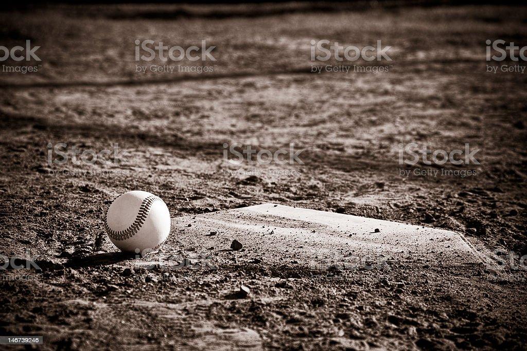 Sepia Tone Baseball and Homeplate stock photo