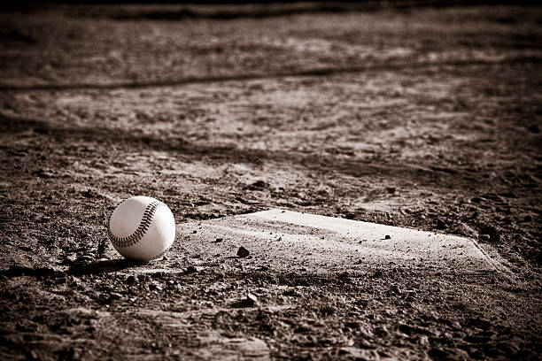 Sepia Tone Baseball and Homeplate stock photo