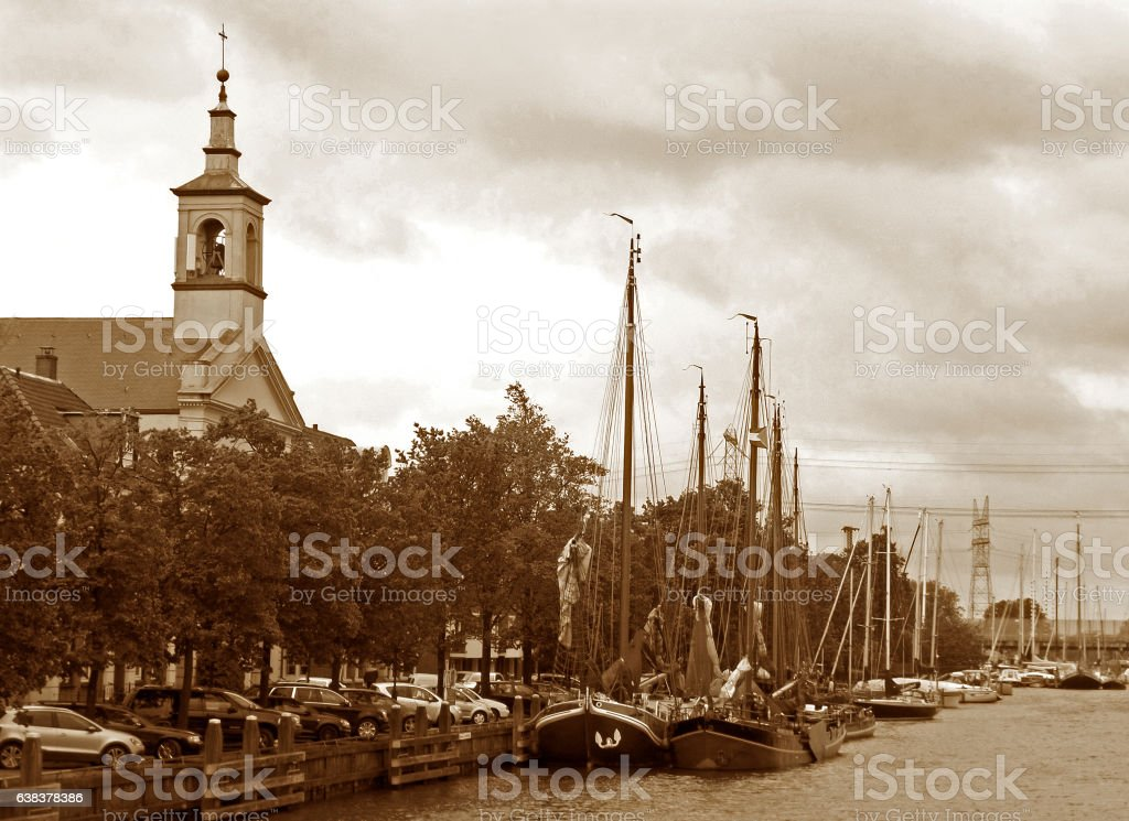 Sepia tone of River marina in front of church, Netherlands stock photo