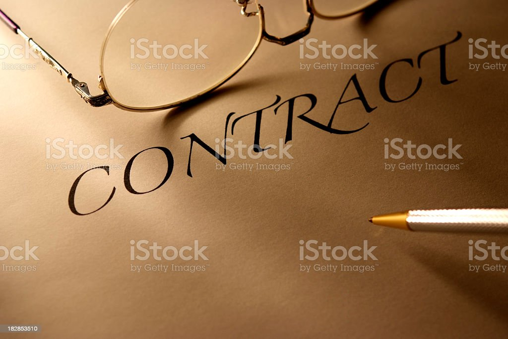 Sepia toned Image of contract with ball-point pen and glasses royalty-free stock photo