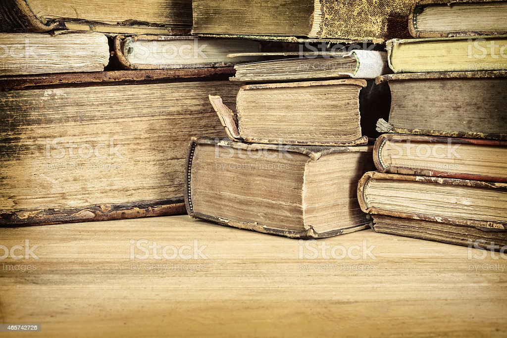 Sepia toned image of old books on a table stock photo